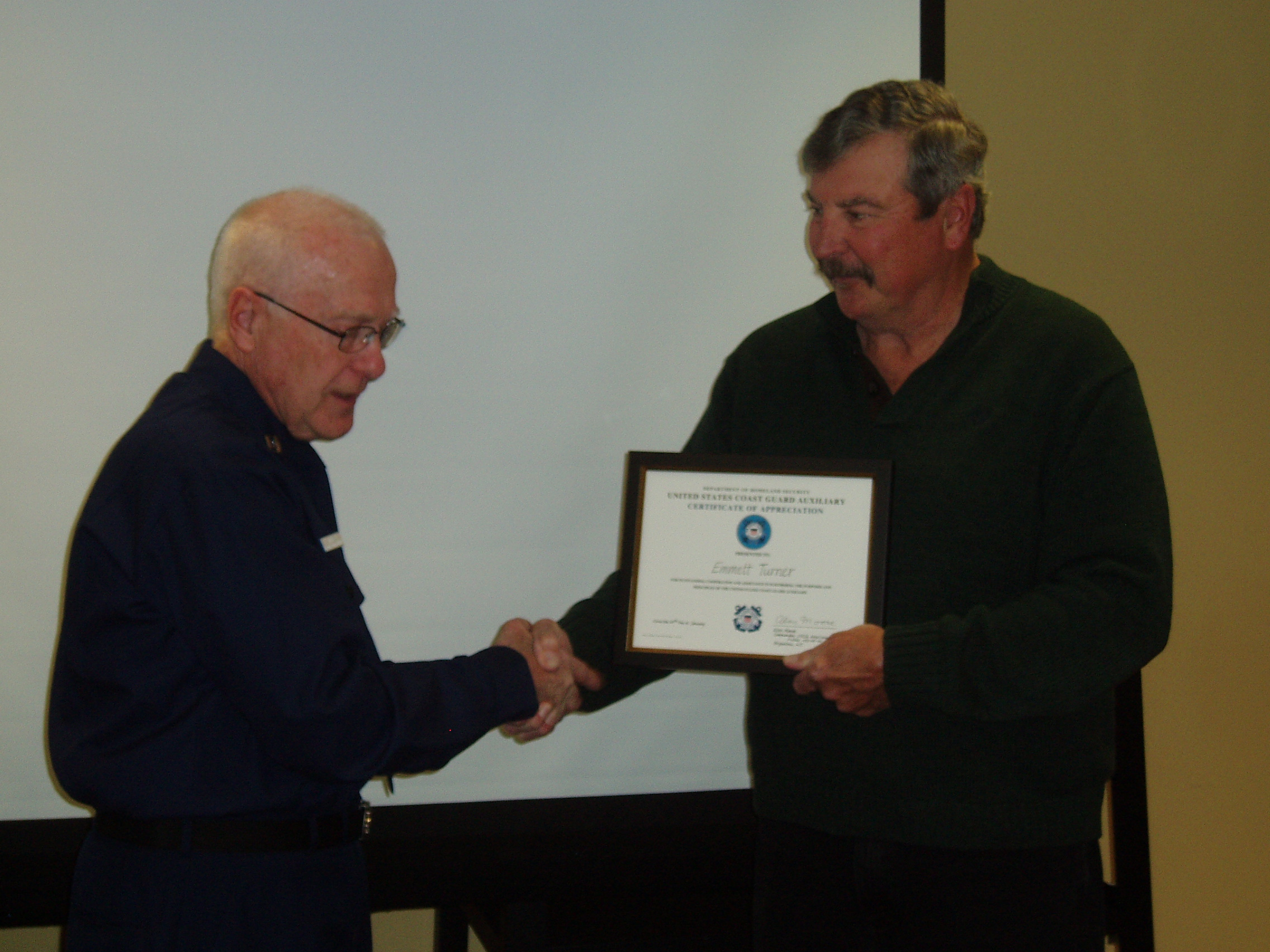 FC Alan Moose presenting a letter of appreciation to Emmett Turner of the Brigantine Times for outstanding coverage of Flotilla 85 activities and articles.