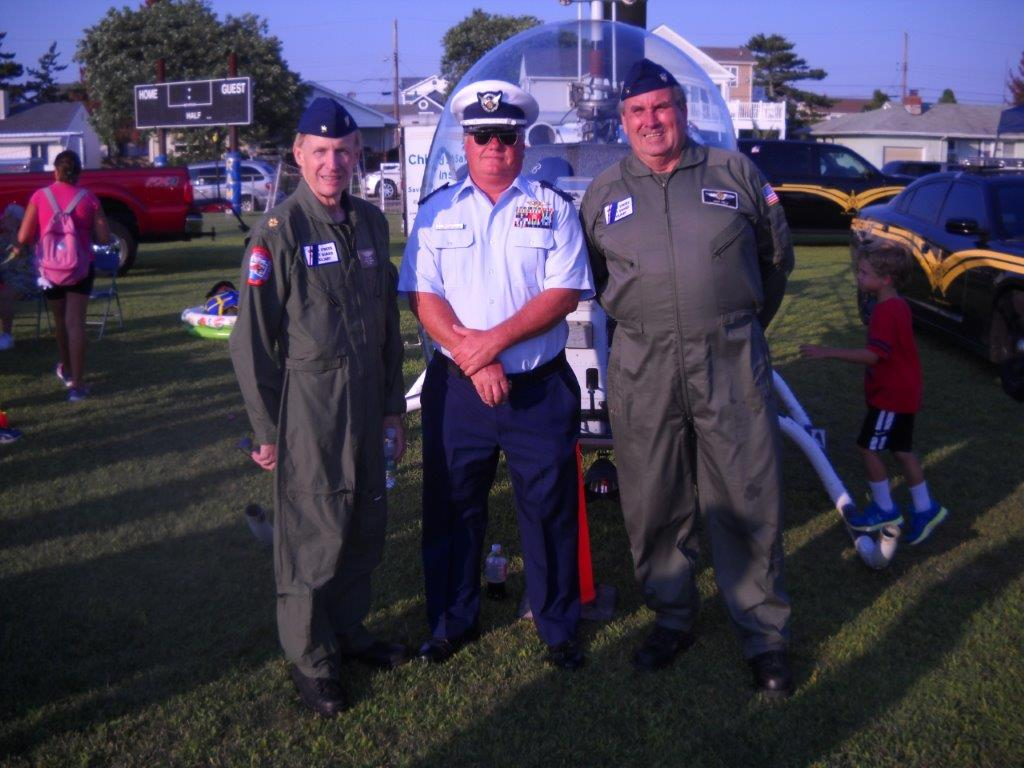 Cris Gleason, Jim Mackey, and Jack Kelly posing with a 1957 Bell Helicopter.